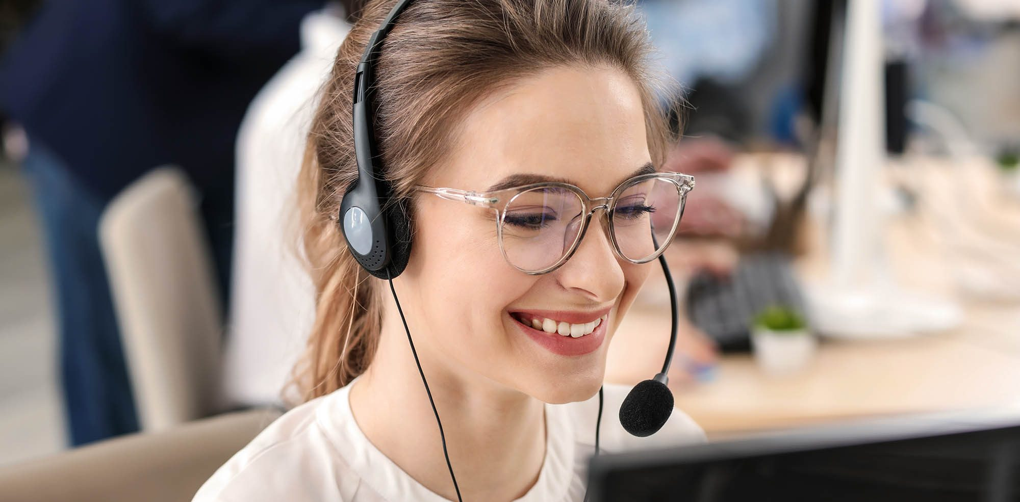 Female technical support agent working in office