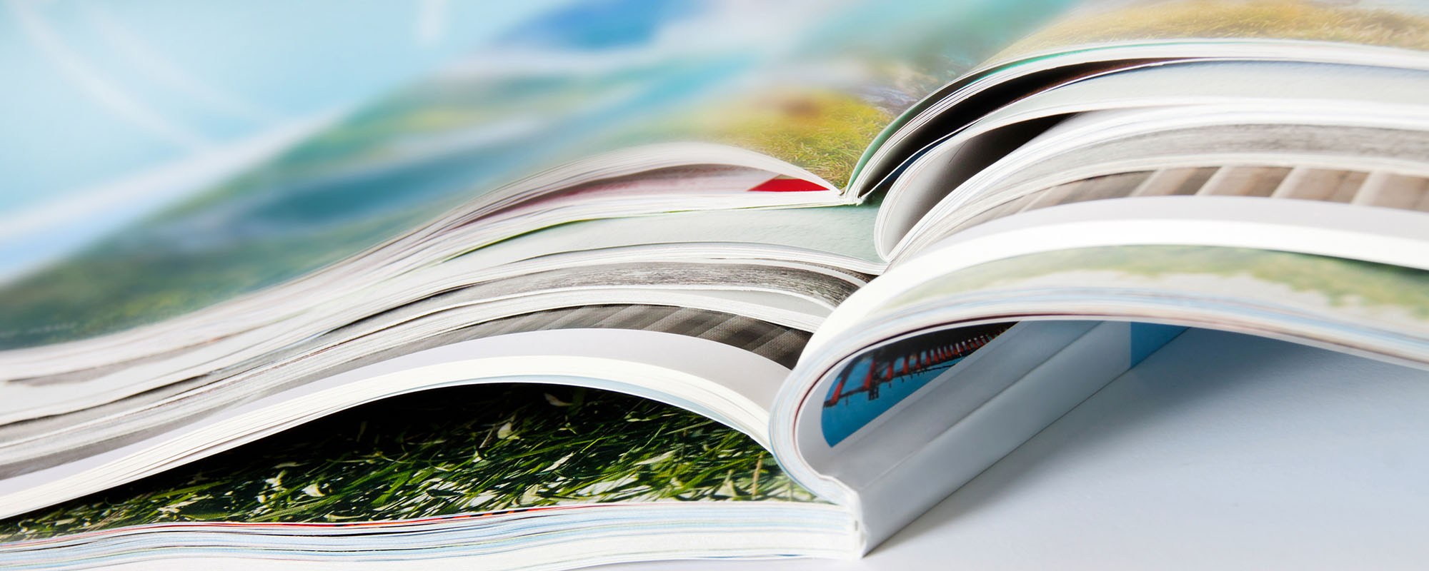 close up of open colorful magazines